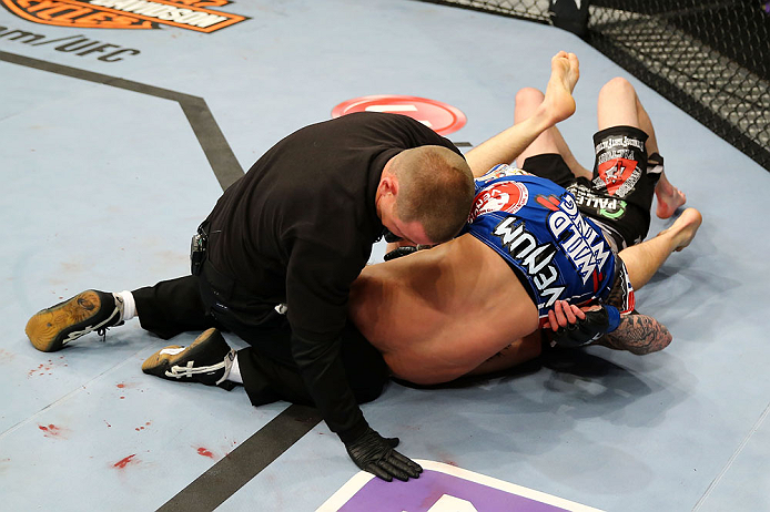 NEWARK, NJ - APRIL 27:  Bryan Caraway submits Johnny Bedford with a  guillotine choke as the referee calls the match in their bantamweight bout during the UFC 159 event at the Prudential Center on April 27, 2013 in Newark, New Jersey.  (Photo by Al Bello/