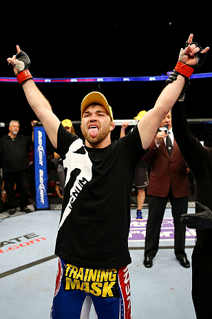 NEWARK, NJ - APRIL 27:  Bryan Caraway celebrates winning by submission (guillotine choke) against Johnny Bedford in their bantamweight bout during the UFC 159 event at the Prudential Center on April 27, 2013 in Newark, New Jersey.  (Photo by Al Bello/Zuff