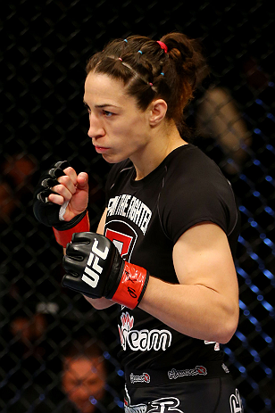 NEWARK, NJ - APRIL 27:  Sara McMann walks to the center of the octagon to fight against Sheila Gaff in their women's bantamweight bout during the UFC 159 event at the Prudential Center on April 27, 2013 in Newark, New Jersey.  (Photo by Al Bello/Zuffa LLC