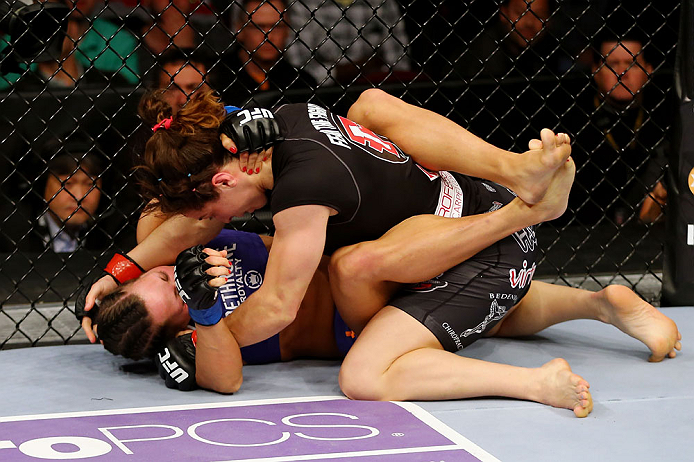 NEWARK, NJ - APRIL 27: Sara McMann (top) battles against Sheila Gaff (bottom) in round one of their women's bantamweight bout during the UFC 159 event at the Prudential Center on April 27, 2013 in Newark, New Jersey.  (Photo by Al Bello/Zuffa LLC/Zuffa LL