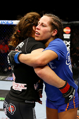 NEWARK, NJ - APRIL 27: Sheila Gaff (R)congratulates Sara McMann (L) on her win by KO/TKO in round one of their women's bantamweight bout during the UFC 159 event at the Prudential Center on April 27, 2013 in Newark, New Jersey.  (Photo by Al Bello/Zuffa L