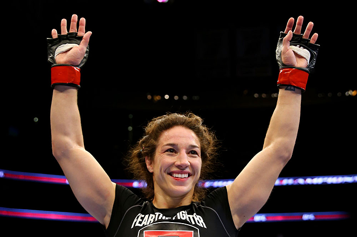 NEWARK, NJ - APRIL 27:  Sara McMann celebrates defeating Sheila Gaff by KO/TKO in round one of their women's bantamweight bout during the UFC 159 event at the Prudential Center on April 27, 2013 in Newark, New Jersey.  (Photo by Al Bello/Zuffa LLC/Zuffa L