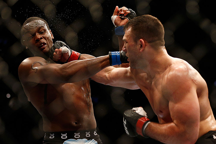 NEWARK, NJ - APRIL 27:   (R-L) Gian Villante punches Ovince Saint Preux in their light heavyweight fight during the UFC 159 event at the Prudential Center on April 27, 2013 in Newark, New Jersey.  (Photo by Josh Hedges/Zuffa LLC/Zuffa LLC via Getty Images