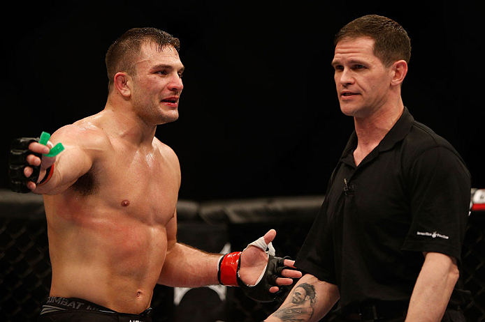 NEWARK, NJ - APRIL 27:   (L-R) Gian Villante argues with referee Kevin Mulholland after a controversial stoppage in his light heavyweight fight against Ovince Saint Preux during the UFC 159 event at the Prudential Center on April 27, 2013 in Newark, New J