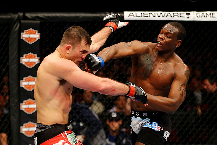 NEWARK, NJ - APRIL 27:  Ovince Saint Preux (R) punches Gian Villante (L) in their light heavyweight bout during the UFC 159 event at the Prudential Center on April 27, 2013 in Newark, New Jersey.  (Photo by Al Bello/Zuffa LLC/Zuffa LLC Via Getty Images)