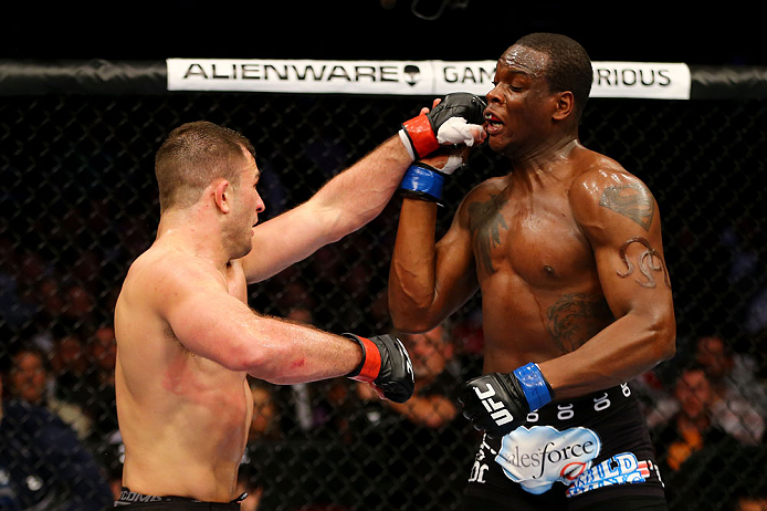 NEWARK, NJ - APRIL 27: (L-R) Gian Villante throws a punch against Ovince Saint Preux in their light heavyweight bout during the UFC 159 event at the Prudential Center on April 27, 2013 in Newark, New Jersey.  (Photo by Al Bello/Zuffa LLC/Zuffa LLC Via Get