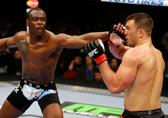 NEWARK, NJ - APRIL 27:  (L-R) Ovince Saint Preux throws a punch against Gian Villante in their light heavyweight bout during the UFC 159 event at the Prudential Center on April 27, 2013 in Newark, New Jersey.  (Photo by Al Bello/Zuffa LLC/Zuffa LLC Via Ge