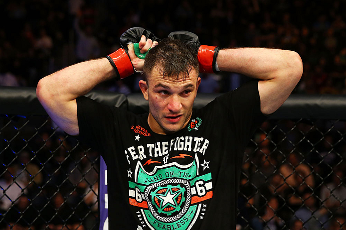 NEWARK, NJ - APRIL 27: Gian Villante reacts after losing by majority technical decision to Ovince Saint Preux in their light heavyweight bout during the UFC 159 event at the Prudential Center on April 27, 2013 in Newark, New Jersey.  (Photo by Al Bello/Zu