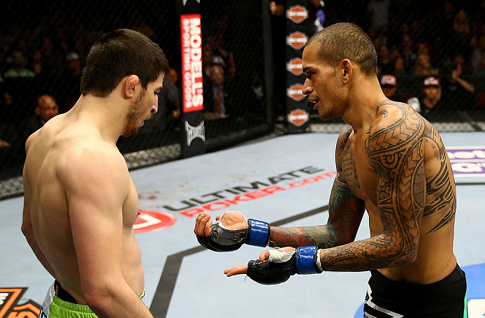 NEWARK, NJ - APRIL 27: Yancy Medeiros (R) shows his injury to Rustam Khabilov (L) of Russia after the stoppage of their lightweight bout during the UFC 159 event at the Prudential Center on April 27, 2013 in Newark, New Jersey.  (Photo by Al Bello/Zuffa L