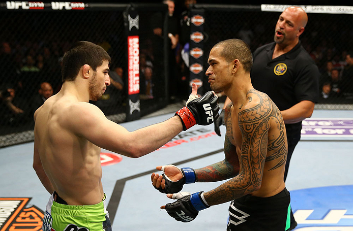 NEWARK, NJ - APRIL 27:  Yancy Medeiros (R) shows his injury to Rustam Khabilov (L) of Russia after the stoppage of their lightweight bout during the UFC 159 event at the Prudential Center on April 27, 2013 in Newark, New Jersey.  (Photo by Al Bello/Zuffa