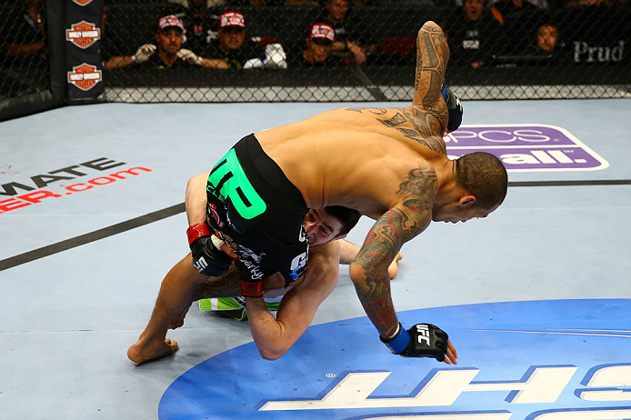 NEWARK, NJ - APRIL 27:  Rustam Khabilov (bottom) of Russia takes down Yancy Medeiros (top) in their lightweight bout during the UFC 159 event at the Prudential Center on April 27, 2013 in Newark, New Jersey.  (Photo by Al Bello/Zuffa LLC/Zuffa LLC Via Get