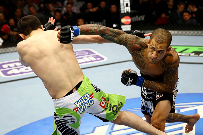 NEWARK, NJ - APRIL 27:  Yancy Medeiros (R) throws a punch against Rustam Khabilov (L) of Russia in their lightweight bout during the UFC 159 event at the Prudential Center on April 27, 2013 in Newark, New Jersey.  (Photo by Al Bello/Zuffa LLC/Zuffa LLC Vi