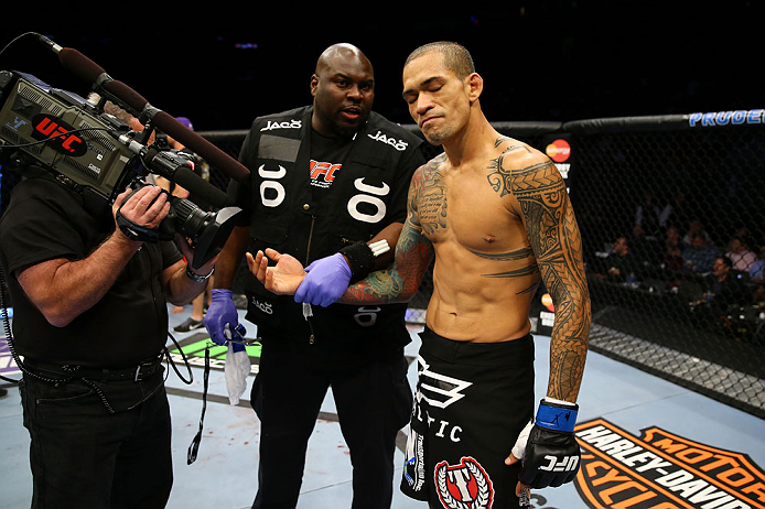 NEWARK, NJ - APRIL 27: Yancy Medeiros has his injured hand evaluated during his lightweight bout against Rustam Khabilov of Russia during the UFC 159 event at the Prudential Center on April 27, 2013 in Newark, New Jersey.  (Photo by Al Bello/Zuffa LLC/Zuf