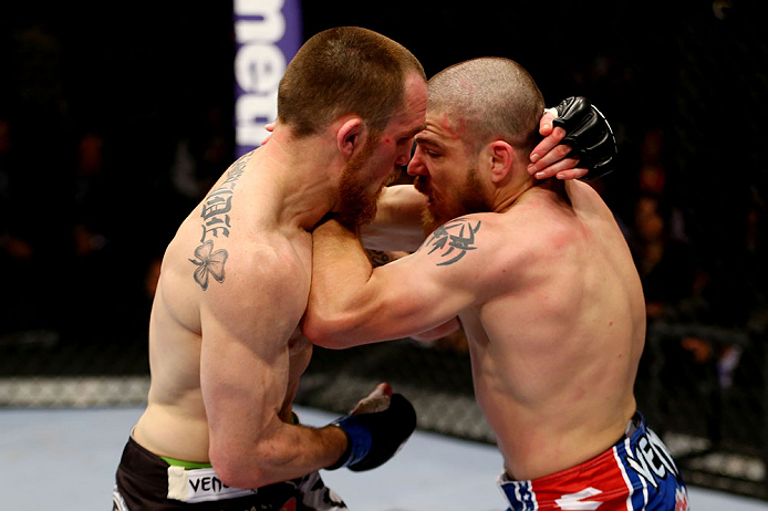 NEWARK, NJ - APRIL 27:  Pat Healy (L) battles against Jim Miller (R) in their lightweight bout during the UFC 159 event at the Prudential Center on April 27, 2013 in Newark, New Jersey.  (Photo by Al Bello/Zuffa LLC/Zuffa LLC Via Getty Images)