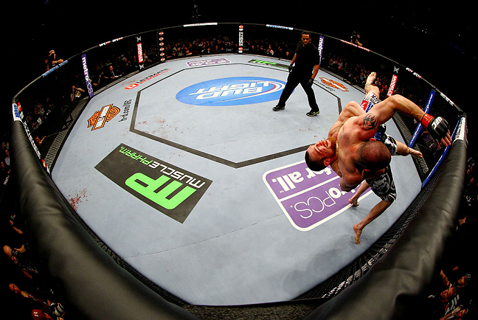 NEWARK, NJ - APRIL 27: Pat Healy (L) throws Jim Miller (R) in their lightweight bout during the UFC 159 event at the Prudential Center on April 27, 2013 in Newark, New Jersey.  (Photo by Al Bello/Zuffa LLC/Zuffa LLC Via Getty Images)
