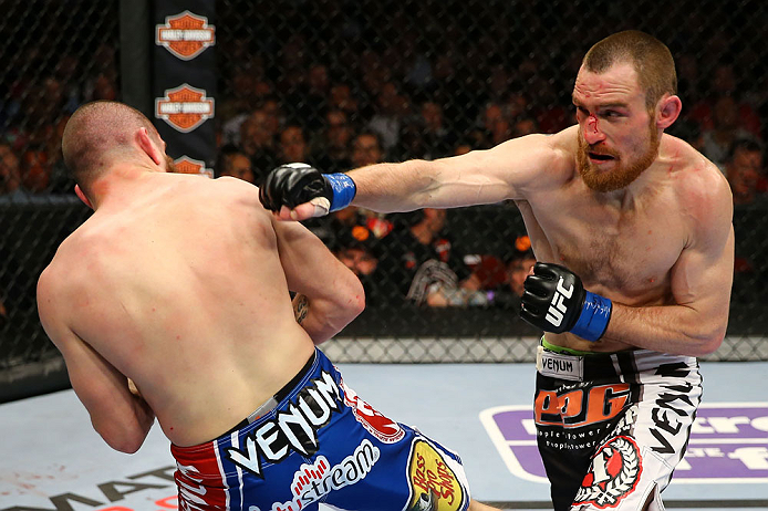 NEWARK, NJ - APRIL 27:  Pat Healy (R) throws a punch against Jim Miller (L) in their lightweight bout during the UFC 159 event at the Prudential Center on April 27, 2013 in Newark, New Jersey.  (Photo by Al Bello/Zuffa LLC/Zuffa LLC Via Getty Images)