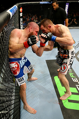 NEWARK, NJ - APRIL 27:  (L-R) Jim Miller fights against Pat Healy in their lightweight bout during the UFC 159 event at the Prudential Center on April 27, 2013 in Newark, New Jersey.  (Photo by Al Bello/Zuffa LLC/Zuffa LLC Via Getty Images)