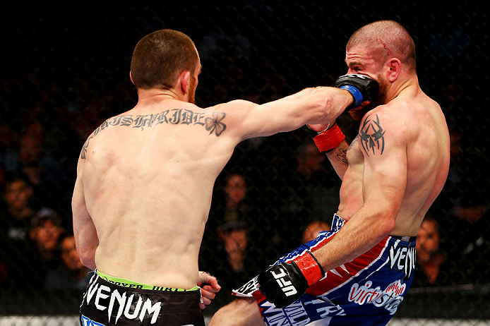 NEWARK, NJ - APRIL 27: (L-R) Pat Healy throws a right punch against Jim Miller in their lightweight bout during the UFC 159 event at the Prudential Center on April 27, 2013 in Newark, New Jersey.  (Photo by Al Bello/Zuffa LLC/Zuffa LLC Via Getty Images)