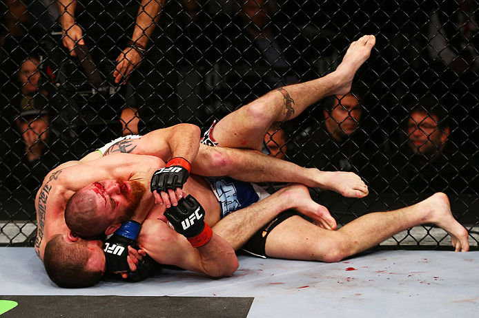 NEWARK, NJ - APRIL 27: Pat Healy performs a rear-naked choke against Jim Miller in the third round of their lightweight bout during the UFC 159 event at the Prudential Center on April 27, 2013 in Newark, New Jersey.  (Photo by Al Bello/Zuffa LLC/Zuffa LLC