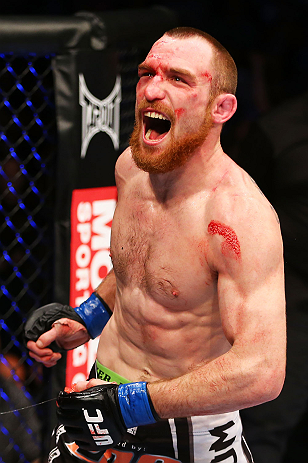 NEWARK, NJ - APRIL 27:  Pat Healy celebrates defeating Jim Miller by Technical Submission (Rear-Naked Choke) in their lightweight bout during the UFC 159 event at the Prudential Center on April 27, 2013 in Newark, New Jersey.  (Photo by Al Bello/Zuffa LLC