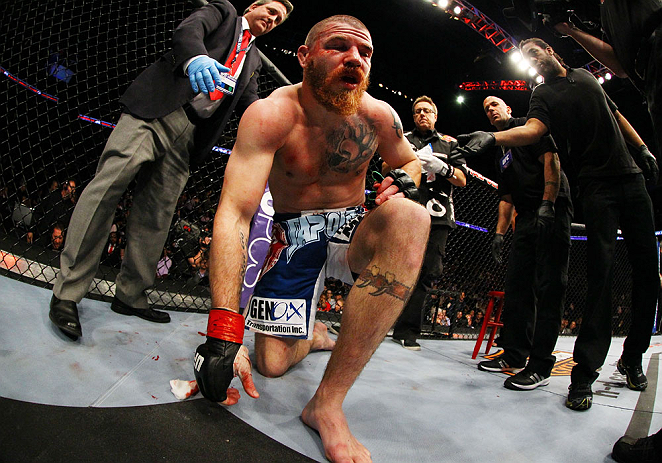 NEWARK, NJ - APRIL 27: Jim Miller stands up after losing by TKO (rear-naked choke) to Pat Healy in the third round of their lightweight bout during the UFC 159 event at the Prudential Center on April 27, 2013 in Newark, New Jersey.  (Photo by Al Bello/Zuf