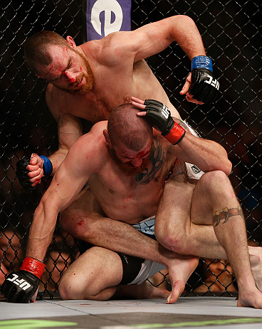 NEWARK, NJ - APRIL 27:   Pat Healy (top) punches Jim Miller in their lightweight fight during the UFC 159 event at the Prudential Center on April 27, 2013 in Newark, New Jersey.  (Photo by Josh Hedges/Zuffa LLC/Zuffa LLC via Getty Images)