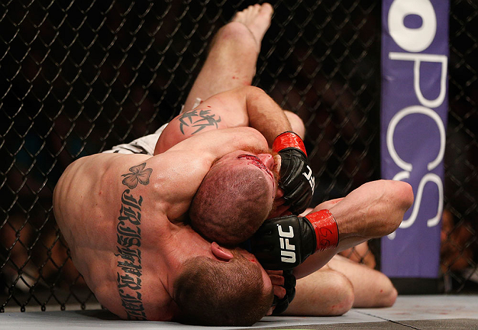 NEWARK, NJ - APRIL 27:   (L-R) Pat Healy secures a rear choke submission against Jim Miller in their lightweight fight during the UFC 159 event at the Prudential Center on April 27, 2013 in Newark, New Jersey.  (Photo by Josh Hedges/Zuffa LLC/Zuffa LLC vi
