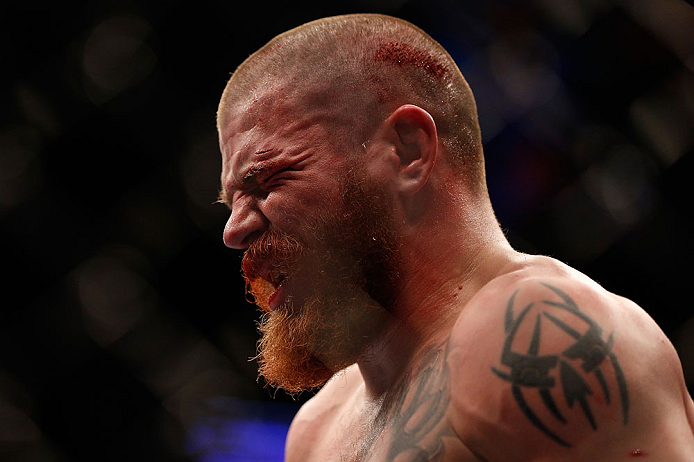 NEWARK, NJ - APRIL 27:   A dejected Jim Miller leaves the Octagon after his loss to Pat Healy in their lightweight fight during the UFC 159 event at the Prudential Center on April 27, 2013 in Newark, New Jersey.  (Photo by Josh Hedges/Zuffa LLC/Zuffa LLC
