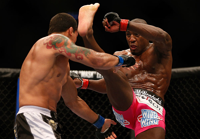 NEWARK, NJ - APRIL 27:   (R-L) Phil Davis kicks Vinny Magalhaes in their light heavyweight fight during the UFC 159 event at the Prudential Center on April 27, 2013 in Newark, New Jersey.  (Photo by Josh Hedges/Zuffa LLC/Zuffa LLC via Getty Images)