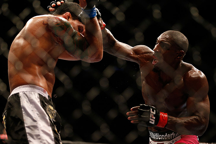 NEWARK, NJ - APRIL 27:   (R-L) Phil Davis punches Vinny Magalhaes in their light heavyweight fight during the UFC 159 event at the Prudential Center on April 27, 2013 in Newark, New Jersey.  (Photo by Josh Hedges/Zuffa LLC/Zuffa LLC via Getty Images)