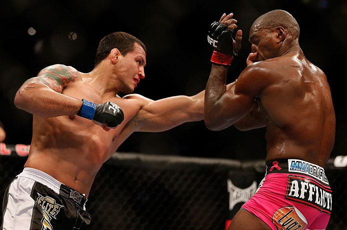 NEWARK, NJ - APRIL 27:   (L-R) Vinny Magalhaes punches Phil Davis in their light heavyweight fight during the UFC 159 event at the Prudential Center on April 27, 2013 in Newark, New Jersey.  (Photo by Josh Hedges/Zuffa LLC/Zuffa LLC via Getty Images)