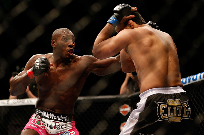 NEWARK, NJ - APRIL 27:   (L-R) Phil Davis punches Vinny Magalhaes in their light heavyweight fight during the UFC 159 event at the Prudential Center on April 27, 2013 in Newark, New Jersey.  (Photo by Josh Hedges/Zuffa LLC/Zuffa LLC via Getty Images)