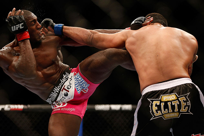 NEWARK, NJ - APRIL 27:   (L-R) Phil Davis and Vinny Magalhaes trade strikes in their light heavyweight fight during the UFC 159 event at the Prudential Center on April 27, 2013 in Newark, New Jersey.  (Photo by Josh Hedges/Zuffa LLC/Zuffa LLC via Getty Im