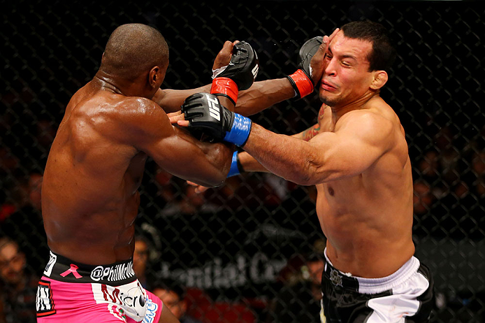 NEWARK, NJ - APRIL 27: Phil Davis throws a punch against Vinny Magalhaes in their light heavyweight bout during the UFC 159 event at the Prudential Center on April 27, 2013 in Newark, New Jersey.  (Photo by Al Bello/Zuffa LLC/Zuffa LLC Via Getty Images)