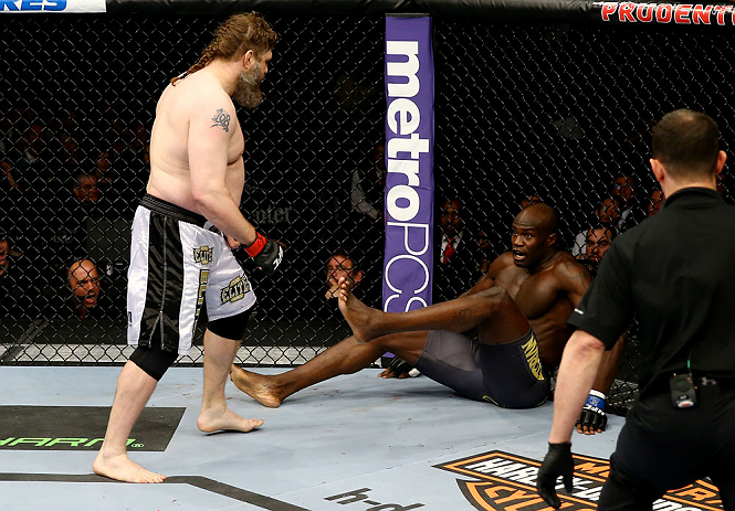 NEWARK, NJ - APRIL 27:  Cheick Kongo (R) of France sits against the cage as Roy Nelson (L) approaches in their heavyweight bout during the UFC 159 event at the Prudential Center on April 27, 2013 in Newark, New Jersey.  (Photo by Al Bello/Zuffa LLC/Zuffa