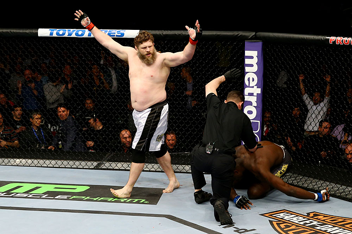 NEWARK, NJ - APRIL 27:  Roy Nelson (L) celebrates his win by knockout against Cheick Kongo (R) of France in their heavyweight bout during the UFC 159 event at the Prudential Center on April 27, 2013 in Newark, New Jersey.  (Photo by Al Bello/Zuffa LLC/Zuf