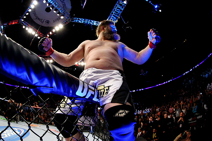 NEWARK, NJ - APRIL 27:  Roy Nelson sits on the side of the octagon in celebration of his win by knockout against Cheick Kongo of France in their heavyweight bout during the UFC 159 event at the Prudential Center on April 27, 2013 in Newark, New Jersey.  (