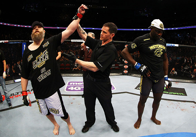NEWARK, NJ - APRIL 27:  Cheick Kongo (R) of France reacts as Roy Nelson (L) is announced winner by knockout by referee Kevin Mulhall (C) after their heavyweight bout during the UFC 159 event at the Prudential Center on April 27, 2013 in Newark, New Jersey