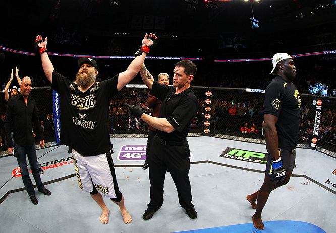 NEWARK, NJ - APRIL 27:  Cheick Kongo (R) of France walks away as Roy Nelson (L) is announced winner by knockout by referee Kevin Mulhall (C) after their heavyweight bout during the UFC 159 event at the Prudential Center on April 27, 2013 in Newark, New Je