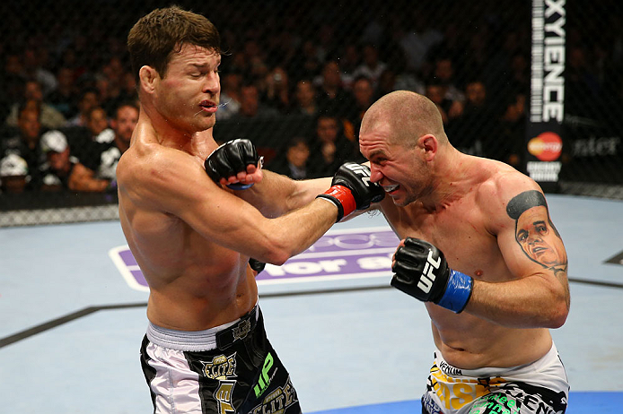 NEWARK, NJ - APRIL 27: (L-R) Michael Bisping of England exchanges punches with Alan Belcher in their middleweight bout during the UFC 159 event at the Prudential Center on April 27, 2013 in Newark, New Jersey.  (Photo by Al Bello/Zuffa LLC/Zuffa LLC Via G