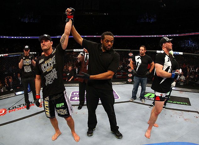 NEWARK, NJ - APRIL 27: Michael Bisping (L) of England is announced winner by unanimous decision against Alan Belcher (R) in their middleweight bout during the UFC 159 event at the Prudential Center on April 27, 2013 in Newark, New Jersey.  (Photo by Al Be