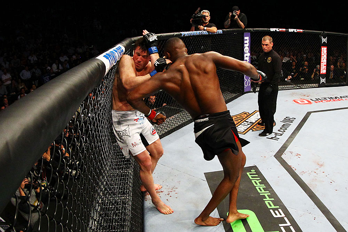 NEWARK, NJ - APRIL 27:  Chael Sonnen defends himself against Jon Jones in their light heavyweight championship bout during the UFC 159 event at the Prudential Center on April 27, 2013 in Newark, New Jersey.  (Photo by Al Bello/Zuffa LLC/Zuffa LLC Via Gett