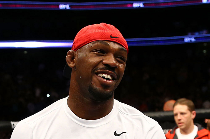 NEWARK, NJ - APRIL 27:  Jon Jones smiles as Pat Healy is announced winner by knockout against Chael Sonnen after their light heavyweight championship bout during the UFC 159 event at the Prudential Center on April 27, 2013 in Newark, New Jersey.  (Photo b