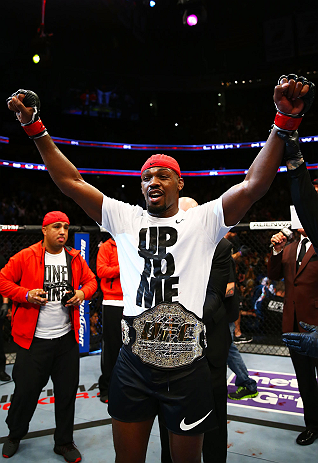 NEWARK, NJ - APRIL 27:  Jon Jones is awarded the championship belt and announced winner by knockout against Chael Sonnen after their light heavyweight championship bout during the UFC 159 event at the Prudential Center on April 27, 2013 in Newark, New Jer