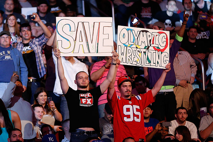 NEWARK, NJ - APRIL 27:   Fans display a sign in support of saving Olympic wresling during the UFC 159 event at the Prudential Center on April 27, 2013 in Newark, New Jersey.  (Photo by Josh Hedges/Zuffa LLC/Zuffa LLC via Getty Images)