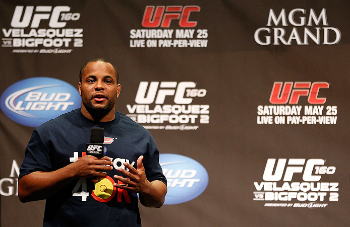 LAS VEGAS, NV - MAY 24:   UFC heavyweight contender and former Oklahoma State and Olympic wrestling standout Daniel Cormier interacts with fans during a Q&A session before the UFC 160 weigh-in at the MGM Grand Garden Arena on May 24, 2013 in Las Vegas, Ne