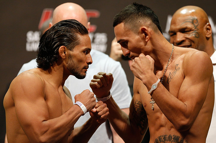 LAS VEGAS, NV - MAY 24:   (L-R) Opponents Dennis Bermudez and Max Holloway face off during the UFC 160 weigh-in at the MGM Grand Garden Arena on May 24, 2013 in Las Vegas, Nevada.  (Photo by Josh Hedges/Zuffa LLC/Zuffa LLC via Getty Images)