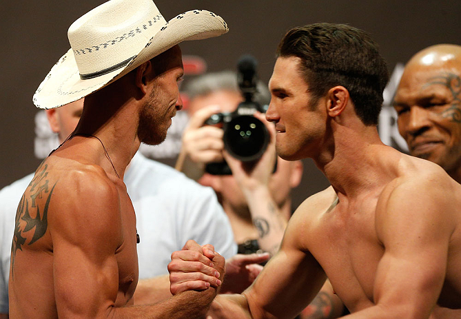 "LAS VEGAS, NV - MAY 24:   (L-R) Opponents Donald ""Cowboy"" Cerrone and Karl ""K.J."" Noons shake hands during the UFC 160 weigh-in at the MGM Grand Garden Arena on May 24, 2013 in Las Vegas, Nevada.  (Photo by Josh Hedges/Zuffa LLC/Zuffa LLC via Getty Images"