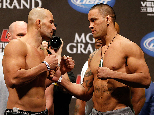 LAS VEGAS, NV - MAY 24:   (L-R) Opponents Glover Teixeira and James Te-Huna face off during the UFC 160 weigh-in at the MGM Grand Garden Arena on May 24, 2013 in Las Vegas, Nevada.  (Photo by Josh Hedges/Zuffa LLC/Zuffa LLC via Getty Images)