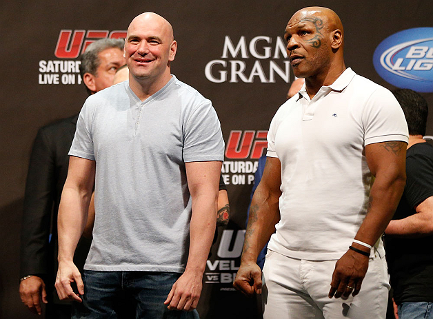 LAS VEGAS, NV - MAY 24:   (L-R) UFC President Dana White and former boxing champion Mike Tyson stand on stage during the UFC 160 weigh-in at the MGM Grand Garden Arena on May 24, 2013 in Las Vegas, Nevada.  (Photo by Josh Hedges/Zuffa LLC/Zuffa LLC via Ge